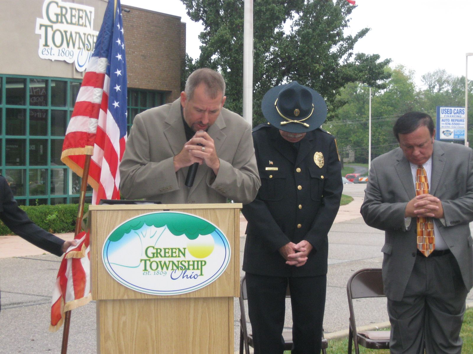 Image of Reverend Seth Bridger, Police Chief Bart West, and Trustee Tony Rosiello observing a moment of silence during the September 11th Memorial Ceremony