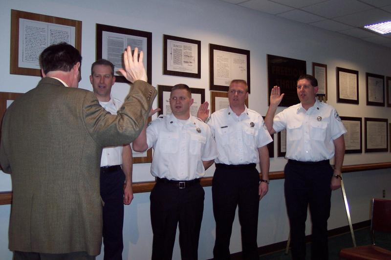 Image of Fiscal Officer Straus swears in four Firefighters being promoted to the rank of Lieutenant Mike Joseph, Arlis Boggs, Allen Boyle and Chris Godfrey