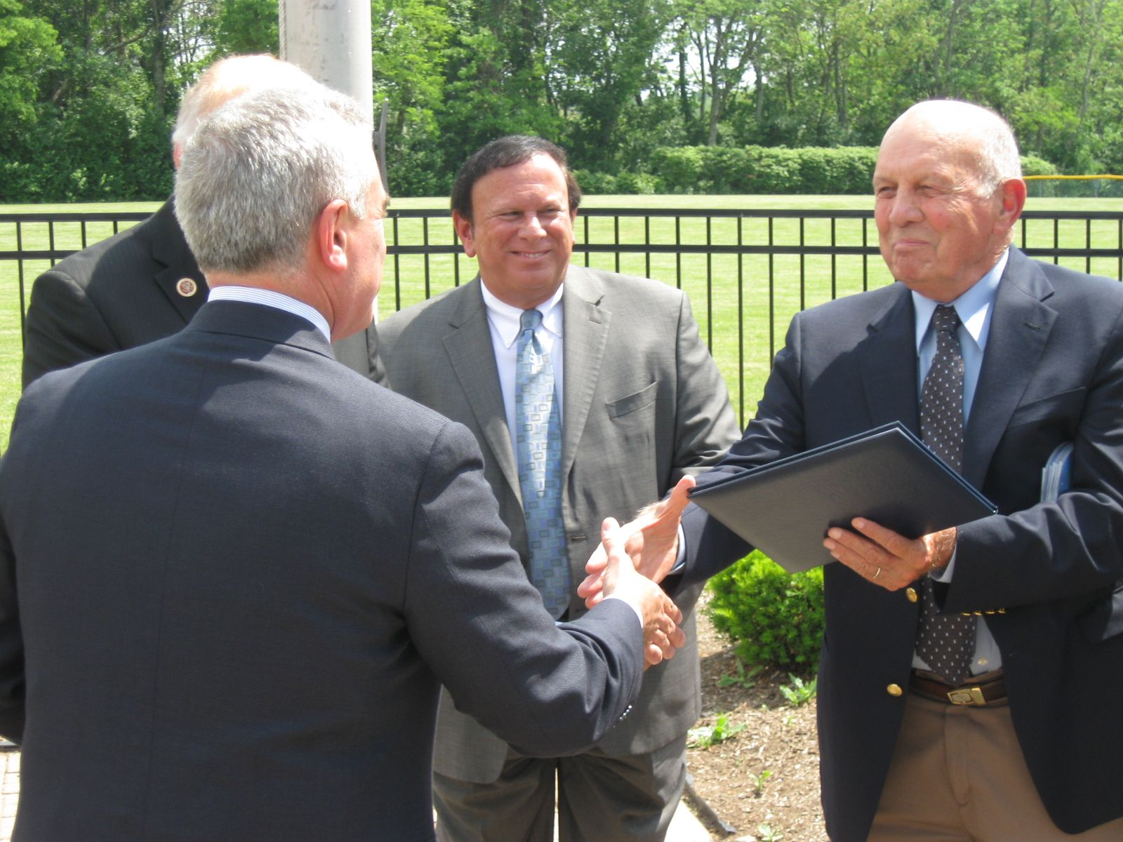 Image of Congressman Brad Wenstrup presented the Proclamation to Don Griffin (Nephew of Tom Griffin) with Trustee Tony Rosiello looking on Veterans Park