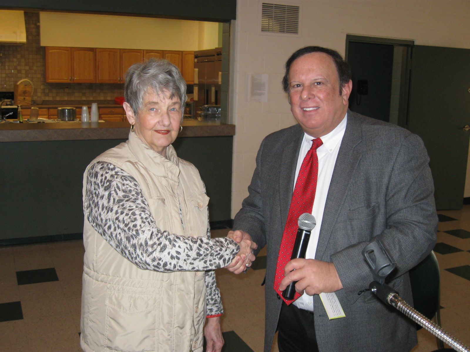 Image of Trustee Tony Rosiello swearing in Lynn Case to her second term as President of the Green Township Senior Center